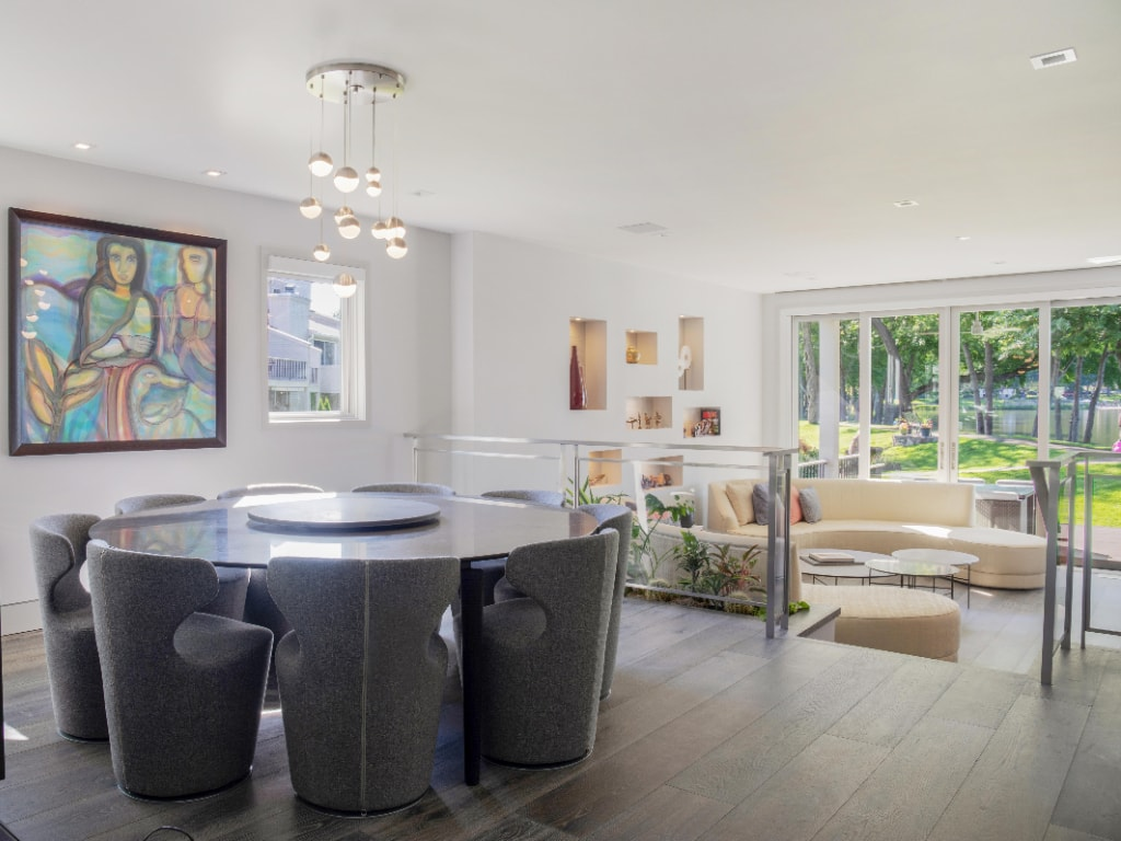 Modern dining and living room in Eastchester NY by DeMotte Architects