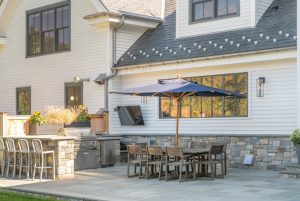 Outdoor kitchen and bar in Greenwich CT modern farmhouse