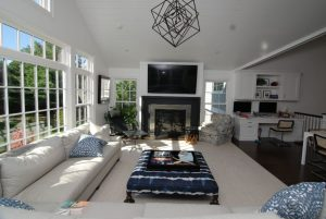 Beautiful family room with large window home design by DeMotte Architects
