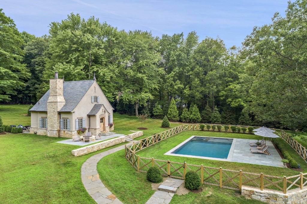 French country pool house in Westchester County NY by DeMotte Architects